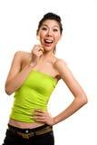 Junge asiatische Frau, die Spaß mit Lutscher hat Stockfotos