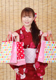 Junge asiatische Frau im Kimono Lizenzfreies Stockbild