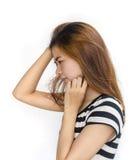 Junge asiatische Frau mit ernstem Blick Lizenzfreies Stockbild