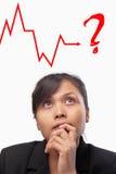 Junge asiatische Geschäftsfrau unsicher Lizenzfreie Stockbilder