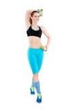 Junge athletische rothaarige Frau in der hellen Sportkleidung Stockfotos