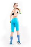 Junge athletische rothaarige Frau in der hellen Sportkleidung Lizenzfreies Stockbild
