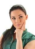 Junge attraktive Frau in einer durchdachten Haltung Lizenzfreies Stockbild