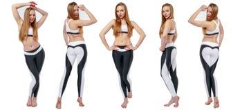 Junge attraktive Frau in fitnes Abnutzung lizenzfreie stockfotos