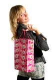 Junge attraktive Frau mit Beuteln nach dem Einkauf Stockfotos