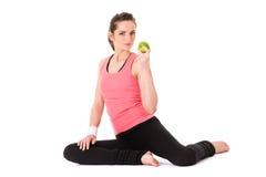 Junge attraktive Frau mit dem grünen Apfel, getrennt Stockbild
