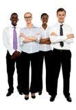 Junge attraktive Geschäftsleute. Arme gefaltet Stockbild