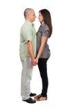 Junge attraktive Paare getrennt auf Weiß Lizenzfreies Stockbild