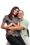 Junge attraktive Paare getrennt auf Weiß Stockfotografie