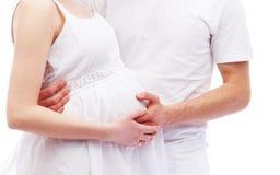 Junge attraktive Paare: schwangere Mutter und Vater Stockbilder