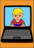 Junge auf Computer Stockfotos