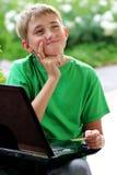 Junge auf Computer Lizenzfreies Stockbild