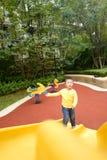 Junge auf dem Spielplatzdia Stockbild