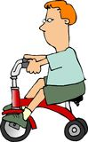 Junge auf einem Dreirad Stockbild