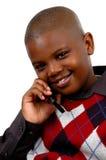 Junge auf einem Handy Lizenzfreie Stockfotos