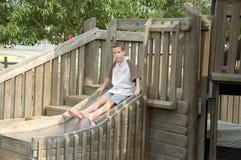 Junge auf Plättchen Lizenzfreie Stockbilder