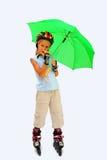 Junge auf Rollen-Rochen Stockbilder