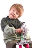 Junge auf Schwingpferd Stockfoto