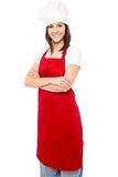Junge Bäckerfrau mit den gefalteten Armen Stockbild