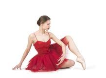 Junge Ballerina in einem roten Ballettröckchen Stockfoto