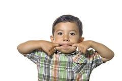 Junge bildet ein Gesicht. Stockfotos