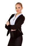 Junge blonde ernste Geschäftsfrau Lizenzfreie Stockfotografie