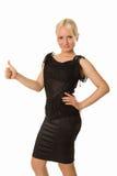 Junge blonde Frau, die mit ihrem Daumen oben steht Stockfotos