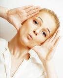 Junge blonde Frau emotional im Studio Stockfotografie