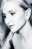 Junge blonde Frau im blauen Sepia Stockfotos
