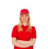 Junge blonde Frau kleidete Händler mit roter Uniform Lizenzfreie Stockfotografie
