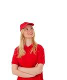 Junge blonde Frau kleidete Händler mit roter Uniform Stockbilder