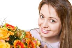 Junge blonde Frau mit Blumen Stockfoto