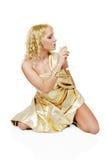 Junge blonde Frau mit Champagnerglas Lizenzfreie Stockfotografie