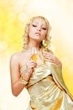 Junge blonde Frau mit Champagnerglas Lizenzfreies Stockbild