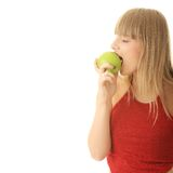 Junge blonde Frau mit grünem Apfel Stockfoto