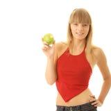 Junge blonde Frau mit grünem Apfel Stockbild