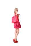 Junge blonde Frau in rosafarbenem Mini Stockfotos