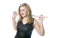 Junge blonde Frau und Flöte gegen weißen Hintergrund Stockbilder