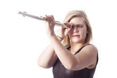 Junge blonde Frau und Flöte gegen weißen Hintergrund Stockbild