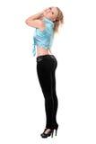 Junge blonde Frauenaufstellung Stockfoto