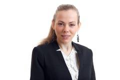 Junge blonde Geschäftsfrau in der klassischen Uniform, welche die Kamera betrachtet Stockbilder