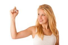 Junge blonde Geschäftsfrau mit blauen Augen, schreibt auf ein Glas ta Lizenzfreie Stockbilder