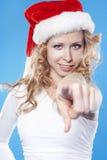 Junge blonde hübsche Sankt-Frau, die auf Sie zeigt Stockfotografie