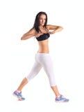 Junge Frau, die sportive Übung tut stockbilder