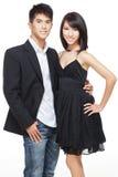 Junge, chinesische Arbeitspaare kleideten für Party an Stockbild