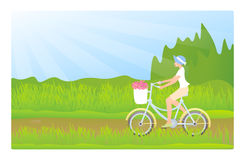 Junge Dame, die ein Fahrrad reitet Lizenzfreie Stockfotos