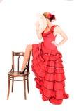 Junge Dame im hispanischen roten Kleid Stockfoto