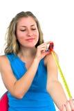 Junge Dame mit einem Tape-measure Lizenzfreie Stockfotografie