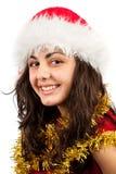 Junge Dame mit Weihnachtsmann-Hut Lizenzfreies Stockbild
