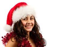 Junge Dame mit Weihnachtsmann-Hut Stockbild